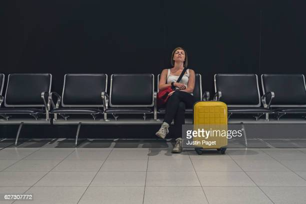 Woman waiting in departure lounge