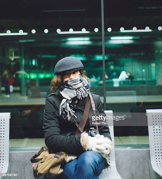 Woman waiting in station