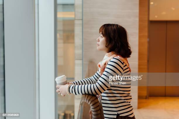 woman waiting near the railing