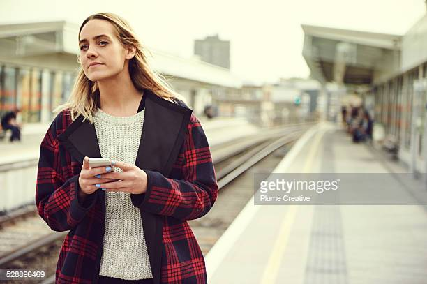 Woman waiting on train platform