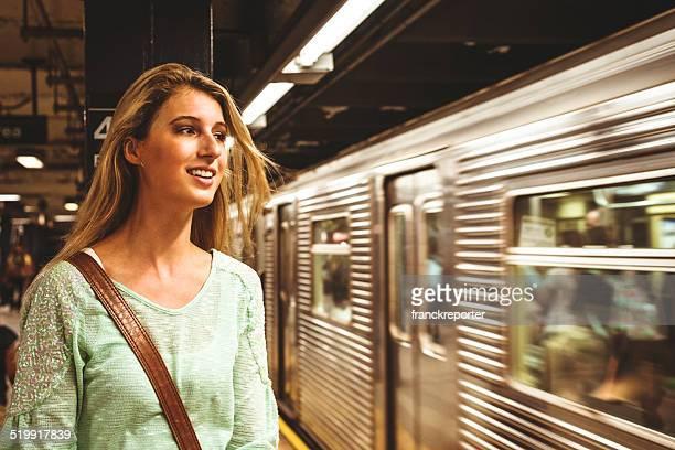 Woman waiting the metro on manhattan subway station