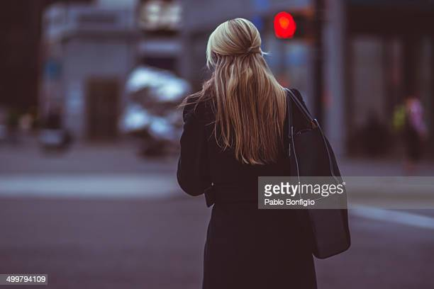 Woman waiting to cross the road
