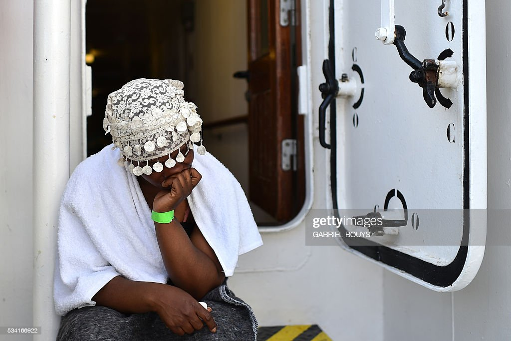 A woman waits aboard the rescue ship 'Aquarius', on May 25, 2016 a day after a rescue operation of migrants and refugees off the Libyan coast. The Aquarius is a former North Atlantic fisheries protection ship now used by humanitarians SOS Mediterranee and Medecins Sans Frontieres (Doctors without Borders) which patrols to rescue migrants and refugees trying to reach Europe crossing the Mediterranean sea aboard rubber boats or old fishing boat. / AFP / GABRIEL