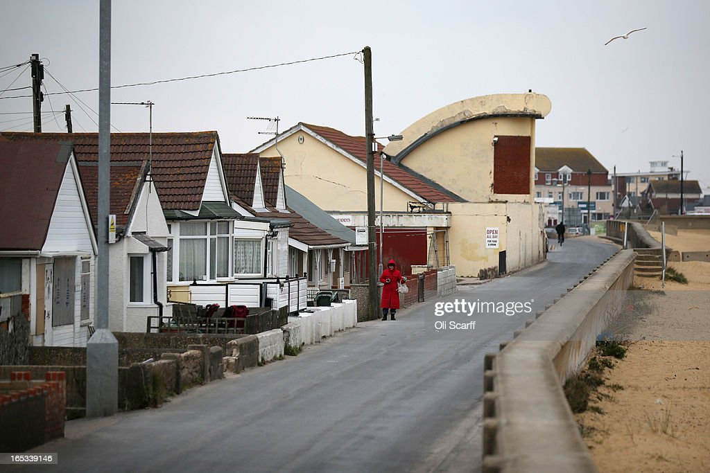 A woman waits for a bus in the seaside town of East Jaywick, the most deprived place in England, on April 3, 2013 in Jaywick, England. The Government's 2011 Indices of Multiple Deprivation' measure ranks Jaywick as the most deprived of all 32,482 small wards in England and Wales. The area also has the greatest number of young people not in employment, education or training; one third of 16 to 24 year-olds claim Jobseeker's Allowance, compared to the national average of 6 per cent. Changes to the benefits and tax system which came into force on April 1, 2013 have included a cut in housing benefit payments for working-age social housing tenants whose property is deemed larger than they need and council tax support payments now being administered locally.
