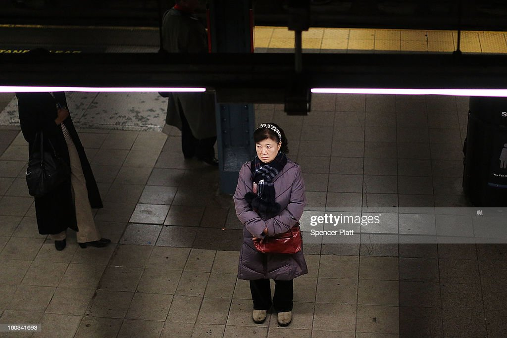 A woman waits for a subway at a Manhattan station on January 29, 2013 in New York City. The city has been experiencing a rash of high-profile incidents involving individuals being hit by trains in suicides, accidents and people being pushed to their deaths. Lawmakers are planning to discuss the recent deaths while also seeking ideas for more safety on the tracks. The New York City subway system, with 468 stations in operation, is the most extensive public transportation system in the world. It is also one of the world's oldest public transit systems, with the first underground line of the subway opening on October 27, 1904.
