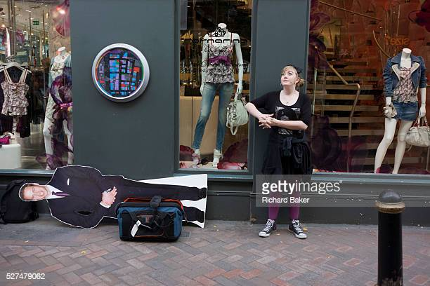 A woman waits for her turn to be interviewed with a lifesize cardboard cutout of Prince William in a London street during the filming of a vox pop In...