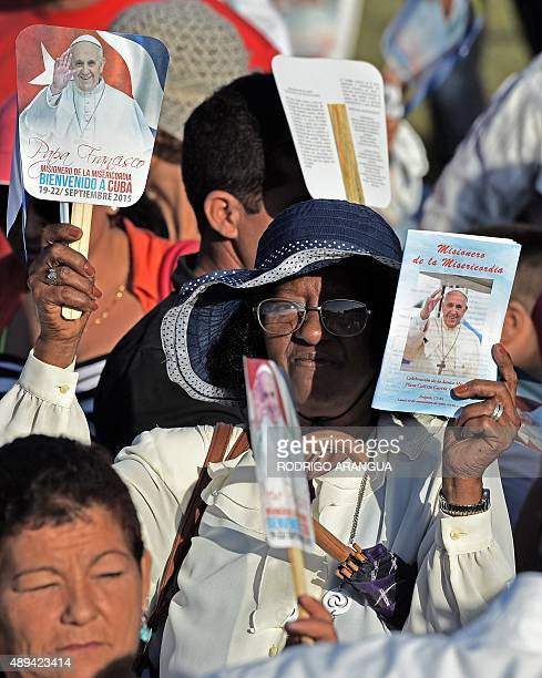 A woman waits for the arrival of Pope Francis at a square named for Cuban independence hero Calixto Garcia in Holguin in eastern Cuba where he will...