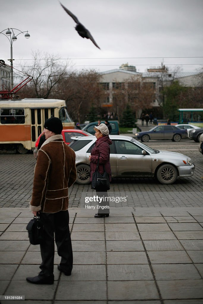 A woman waits for the bus on November 3, 2011 in Yekaterinburg, Russia. Yekaterinburg is one of thirteen cities proposed as a host city for the 2018 FIFA World Cup in Russia.