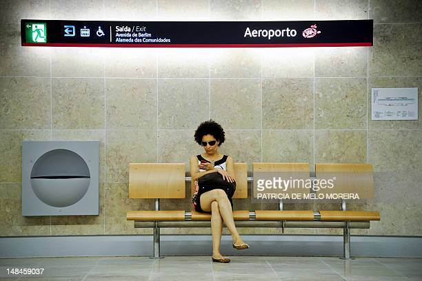 A woman waits for the subway at the Lisbon airport subway station on July 17 2012 Metro Lisbon inaugurated on July 16 2012 three new subway stations...