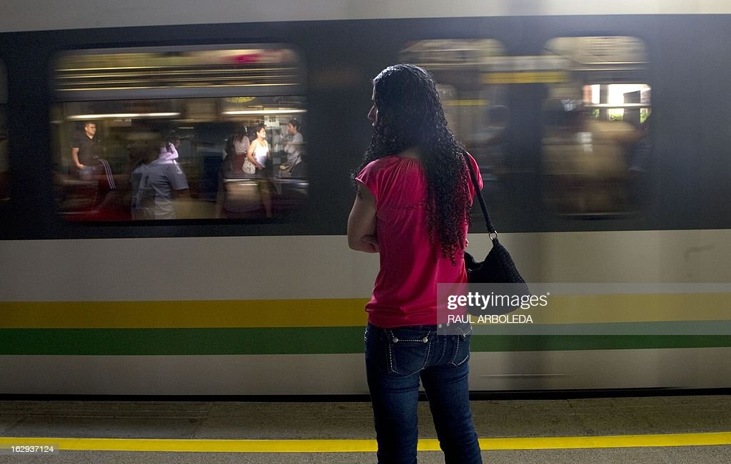 "A woman waits for the subway in Medellin, Antioquia department, Colombia on March 1, 2013. Medellin, which competed with New York and Tel Aviv, was chosen by popular vote through the internet, as the ""Innovative City of the Year"" during the City of the Year contest, organized by The Wall Street Journal and Citigroup. The distinction was basically made for its modern transportation system, its public library, escalators built in a shantytown and schools that have allowed the integration of society. AFP PHOTO/Raul ARBOLEDA"