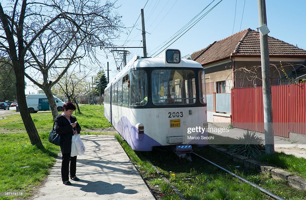 A woman waits for the tram just few stops from the city centre on April 16, 2013 in Timisoara, Romania. Romania has abandoned a target deadline of 2015 to switch to the single European currency and will now submit to the European Commission a programme on progress towards the adoption of the Euro, which for the first time will not have a target date.
