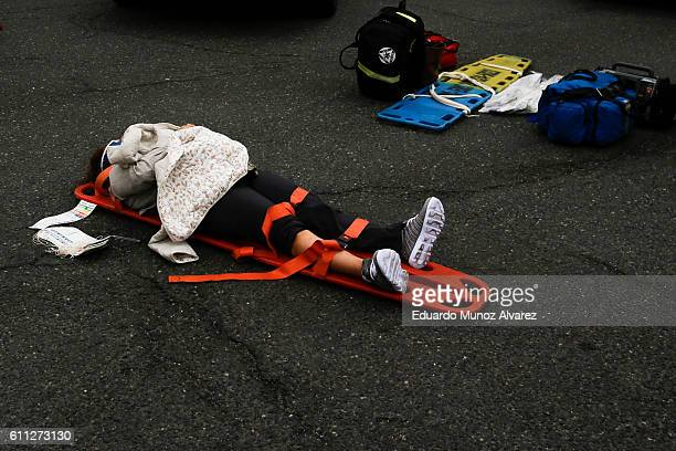 A woman waits for treatment of her injuries outside after a New Jersey Transit train crashed into the platform at Hoboken Terminal during morning...