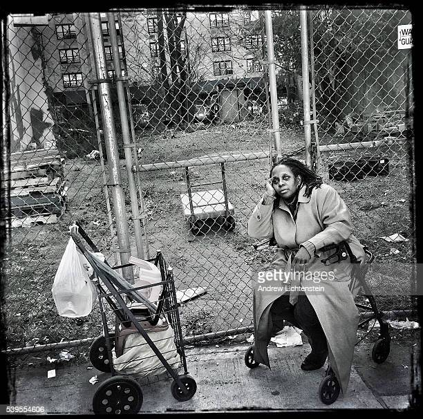 A woman waits in line outside of a soup kitchen and food pantry in Coney Island Brooklyn