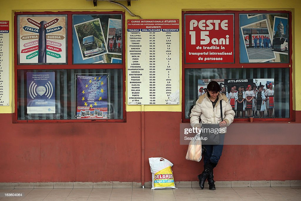 A woman waits next to signs announcing bus travel to countries and cities in western Europe at the Rahova international bus terminal on March 13, 2013 in Bucharest, Romania. Both Romania and Bulgaria have been members of the European Union since 2007 and restrictions on their citizens' right to work within the EU are scheduled to end by the end of this year. However Germany's interior minister announced recently that he would veto the two countries' entry into the Schengen Agreement, which would not affect labour rights but would prevent passport-free travel.