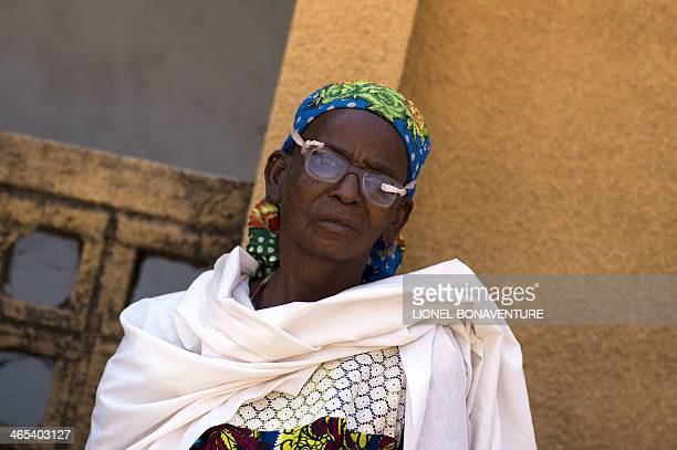A woman waits on January 25 2014 to see an ophthalmologist in Leo Burkina Faso The French cosmetics company L'Occitane has been working with women...