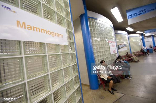 A woman waits outside the mammogram and women's health services area on the first day of the fourth annual free health clinic at the Los Angeles...