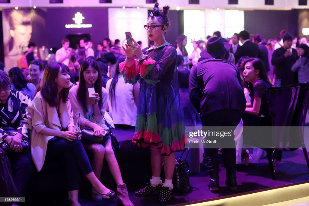 A woman waits to attend the Audi Star Creation Capsule Showcase on May 17, 2013 in Singapore.