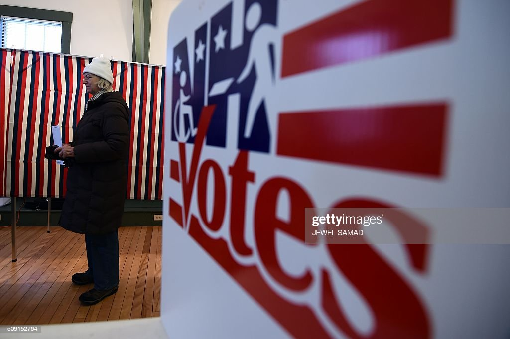 A woman waits to cast her ballot the first US presidential primary at the town hall in Canterbury, New Hampshire, on February 9, 2016. New Hampshire began voting on February 9 in the first US presidential primary with Republican Donald Trump calling on supporters to propel him to victory and Democrat Bernie Sanders primed to upstage Hillary Clinton. The northeastern state, home to just 1.3 million people, sets the tone for the primaries and could shake out a crowded Republican field of candidates pitting Trump and arch-conservative Senator Ted Cruz against more establishment candidates led by Senator Marco Rubio. / AFP / Jewel Samad