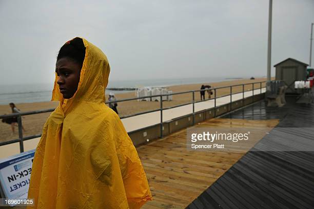 A woman waits to hear President Barack Obama speak along a rain soaked boardwalk in Asbury Park on May 28 2013 in Asbury Park New Jersey Seven months...