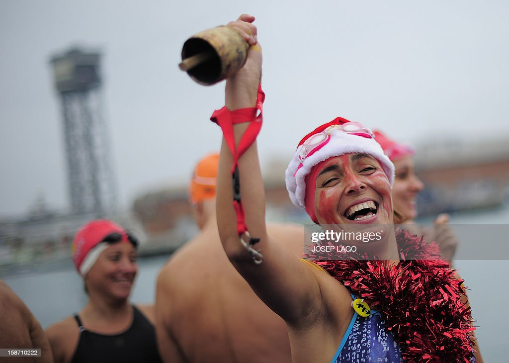 A woman waits to take part in the103rd edition of the Copa Nadal (Christmas Cup) at Barcelona's Port Vell on December 25, 2012. The traditional 200-meter Christmas swimming race gathered around 400 participants at the Old Harbour of Barcelona.