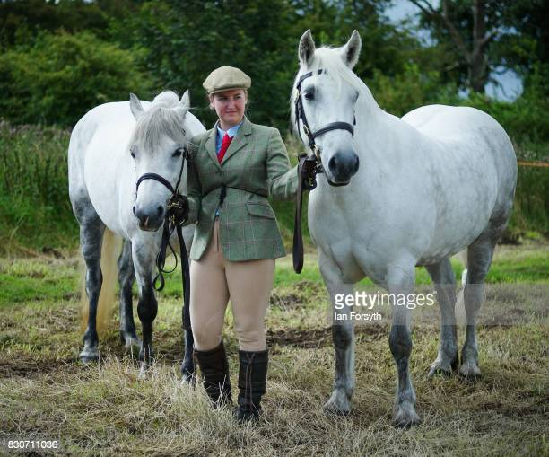 A woman waits with her horses before competing during the 194th Sedgefield Show on August 12 2017 in Sedgefield England The annual show is held on...