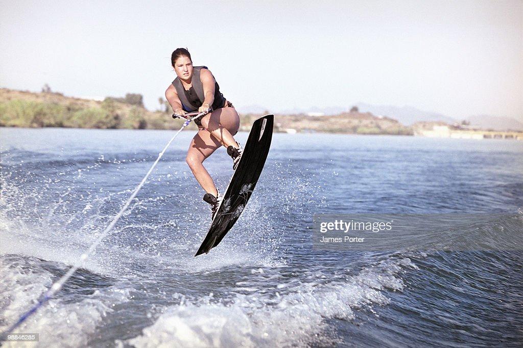 Woman wakeboarding : Stock Photo