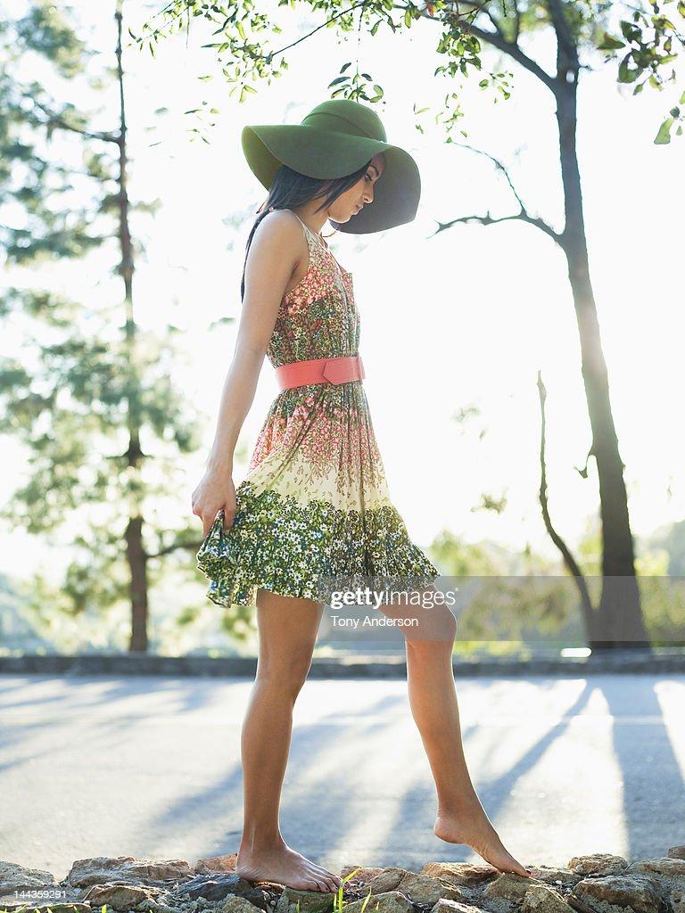 Woman walkiing on rock wall outdoors : Stock Photo