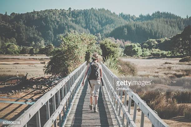 Woman Walking Abel Tasman Coast Track, New Zealand South Island
