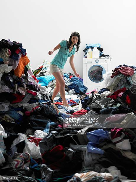 Woman walking across clothes in laundry room