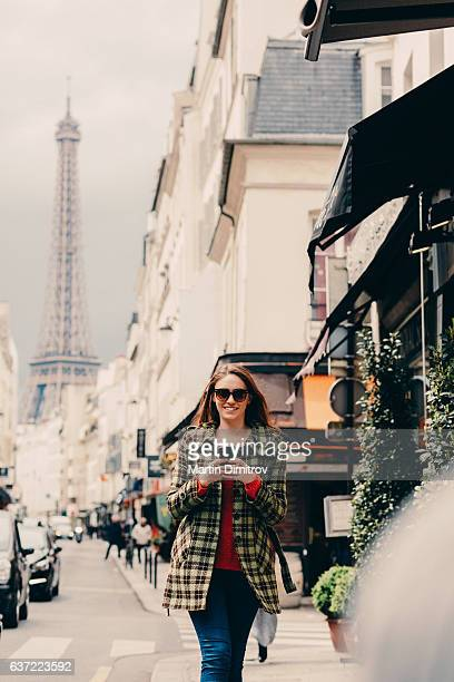 Woman walking at the street in Paris