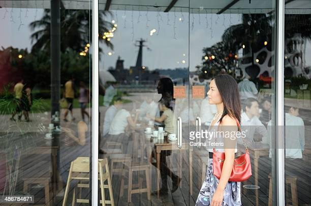 Woman walking by a coffee shop