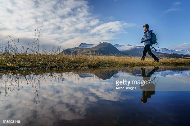 Woman walking by a lake, Iceland