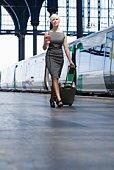 Woman walking by train