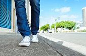 Woman walking down the street.