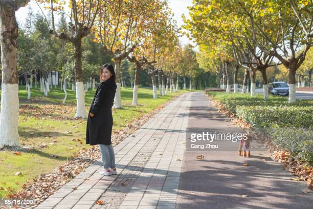 woman walking her dog in park