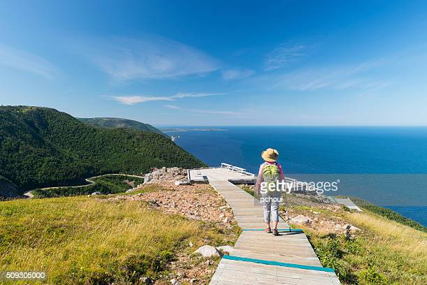 Woman walking, hiking, Skyline, Cabot trail, Cape Breton, Nova Scotia