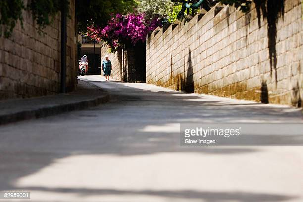Woman walking in a street, Sorrento, Sorrentine Peninsula, Naples Province, Campania, Italy