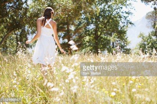 Woman walking in field : Stock Photo