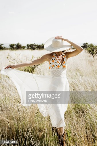 Woman walking in field. : Stock Photo