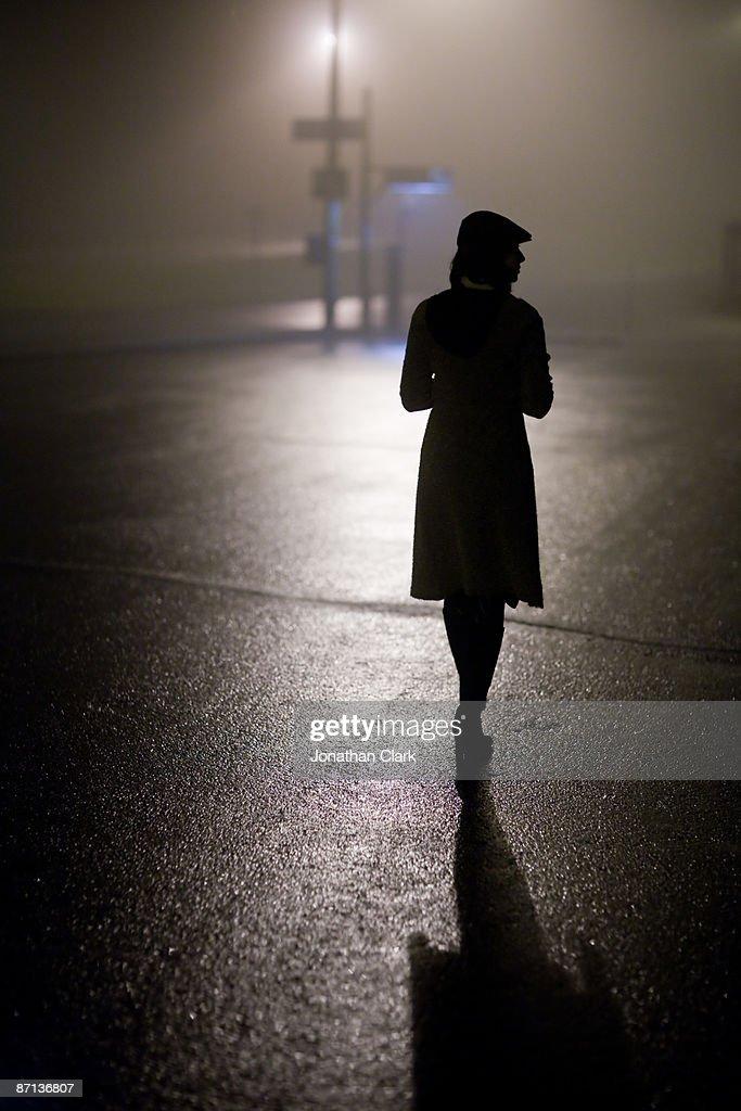 Woman walking in Fog : Stock Photo