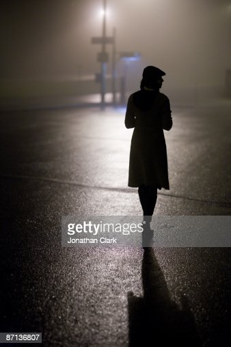 Woman walking in Fog : Stock Photo