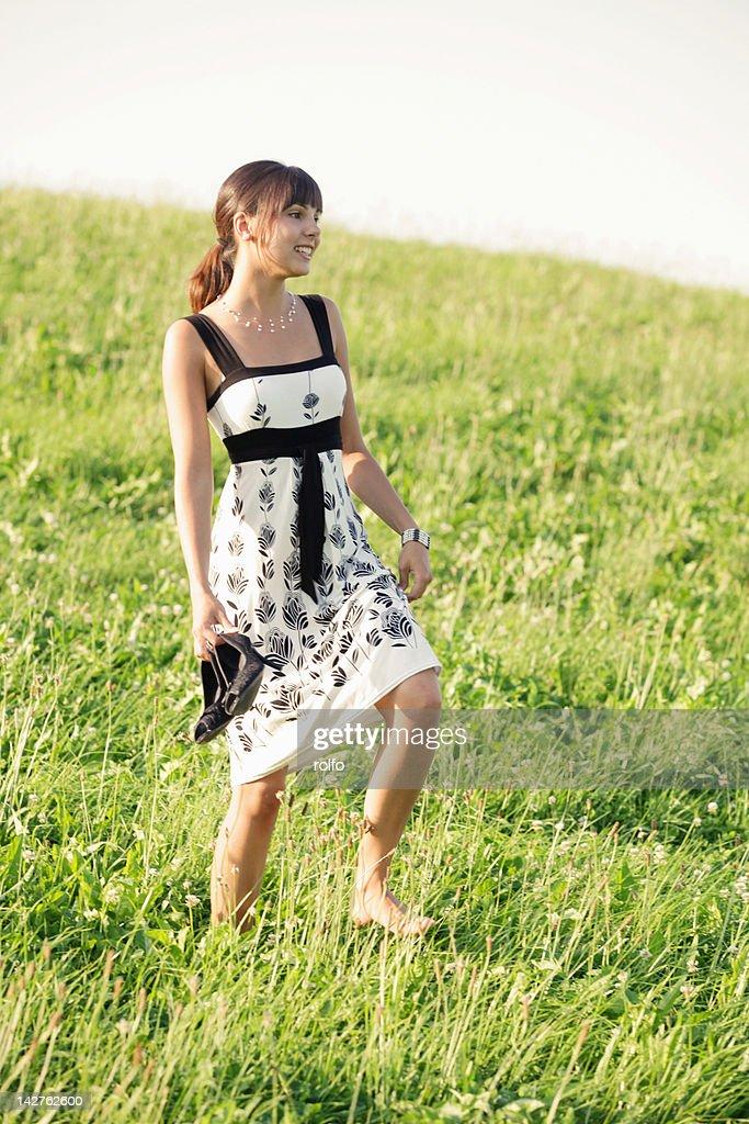 woman walking in grass - photo #12
