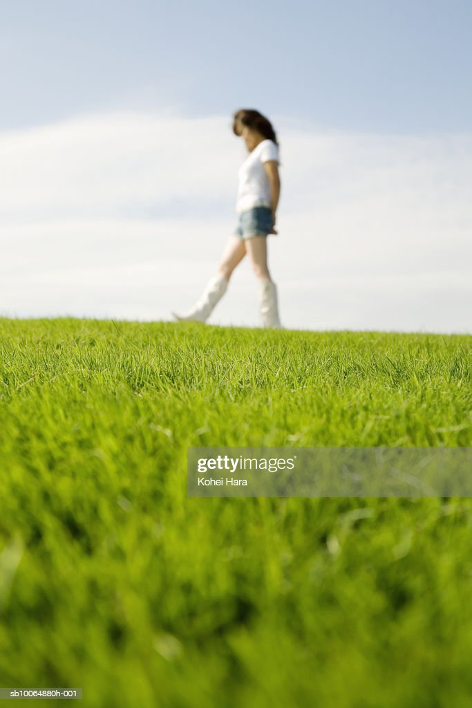 woman walking in grass - photo #6