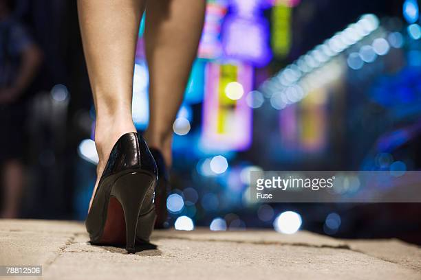 Woman Walking in High Heels at Night