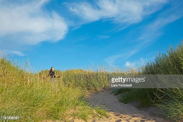 Woman walking in long grass