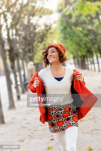 Woman Walking in Palais Royal park, Paris : Stock Photo