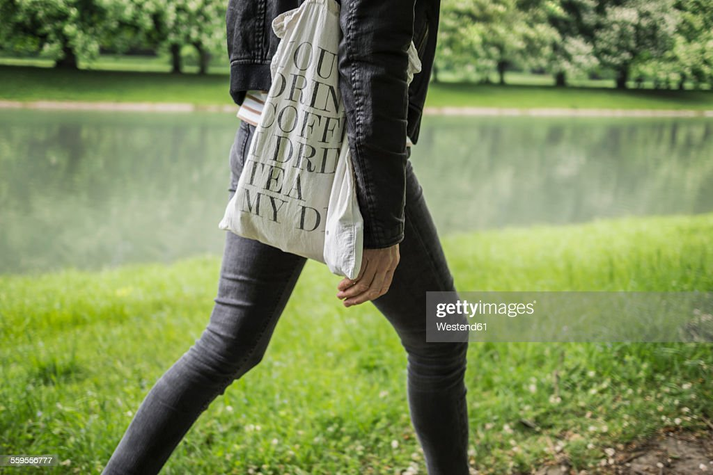 Woman walking in park at the waterside