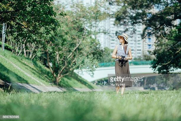 Woman walking in park relaxingly enjoying nature