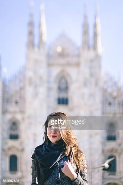 Woman walking in Piazza Duomo in Milan