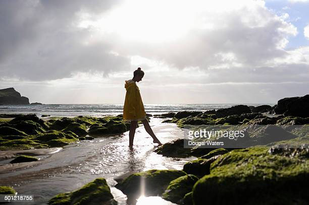 Woman walking in rock pool at beach